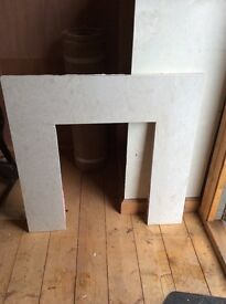 Stone fire surround and hearth for sale.