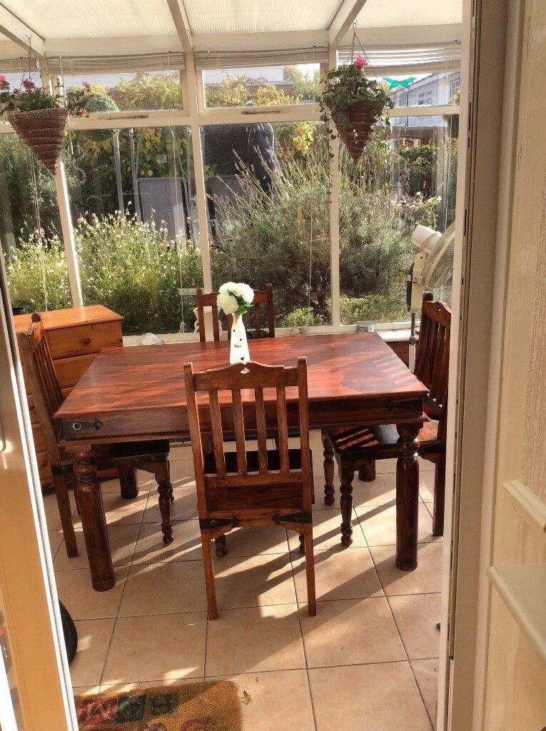 RUSTIC OBLONG TABLE AND FOUR CHAIRS HEAVY NICE SET WITH GREAT LEGS AND FEATURES