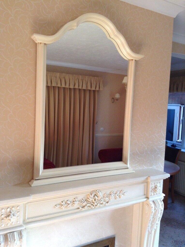 John Lewis Curved top mirror.