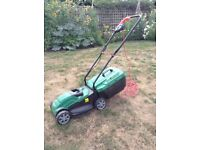 Qualcast electric lawn mower, 32cm cut. 1 year old, hardly used. Excellent condition