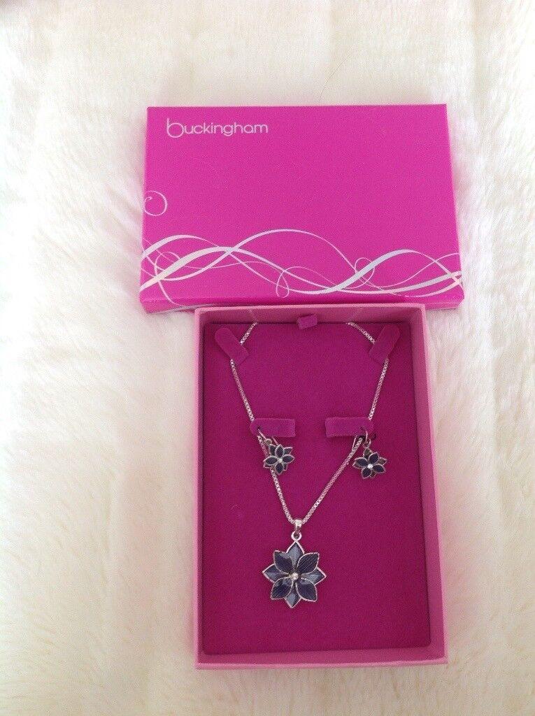 Buckingham Necklace Earring Set Brand New. Never been out of Box. Colour Bleuy/Grey diamanté centre