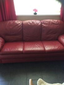 2 red leather 3 seater settees
