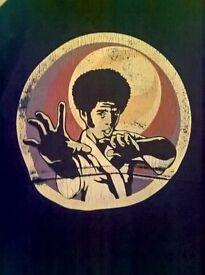 genuine 1970s retro jacket, back print of afro haired karate fighter,navy blue white buttons.