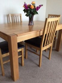 Solid Light oak table and chairs