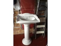 White washbasin and pedestal free for collection.