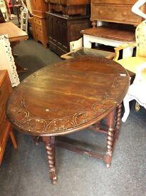 Solid oak carved dropleaf dining table