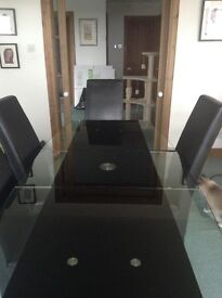 Contemporary black glass dinning table extendable with six high back leather chairs