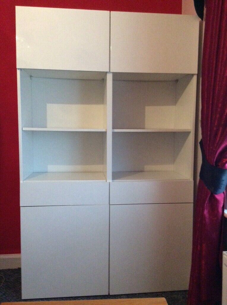 Tall White high gloss units. With interchangeable drawers shelves and cupboards , 1 x double ...