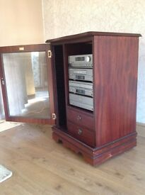 Media Cabinet with glass door, drawers and CD holder tower.