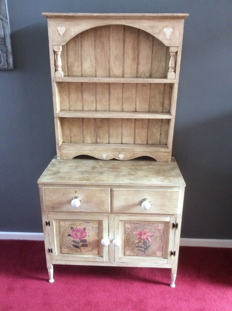 Antique distressed dresser and top rack.