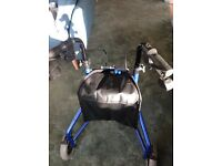 Three wheeled mobility walker in blue with basket, bag and tray