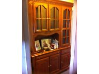 lovely unit which has glass cabinet at the top and cupboards