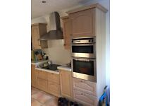 Lots of kitchen units - no worktops but Neff double oven, and Blanco extractor hood