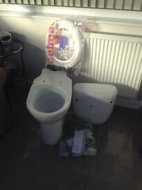 Comfort height toilet pan, cistern, seat and fittings. New