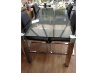 Solid glass dining table with four faux leather chairs (new)