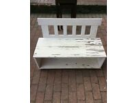Quirky small garden bench in need of some tlc