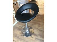 Two brown bar stools for sale