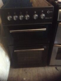 Electric cooker,ceramic surface.,black,next to. Ew condition, ,£150.00