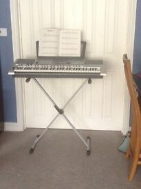 Yamaha PSR-E403 keyboard with manual, charger, stand, music stand and 18 music books
