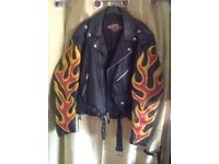 Black leather motorcycle jacket with stitched leather flames on each arm.