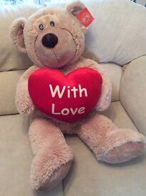 Giant teddy with heart