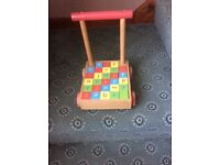 Child's wooden walker with complete set of bricks. Suitable for small toddler. Good condition.£10
