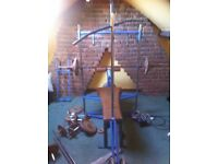 multi gym and weights bench + lots of weights and bars