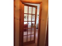 Four solid pine doors, plus two glass panelled doors for sale