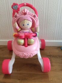 Fisher price push along buggy walker including doll.