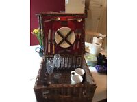 Wicker picnic hamper with cutlery