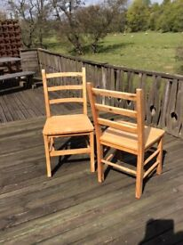 Two wooden kitchen chairs