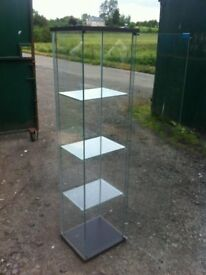 Glass display cabinet with three glass shelves in excellent condition