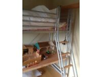 High sleeper bed with lots ao space below either for toys or table .