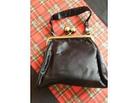 Small handbag with leopard print lining