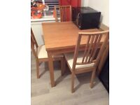 Ikea Oak dinning table and 4 oak chairs