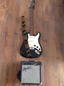 Encore S -Style guitar with strap & Squier amp.