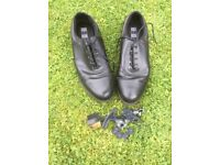 Pair of size 10 Nike golf shoes in black