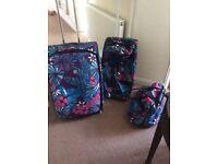 Suitcase and matching holder on wheels and big bag