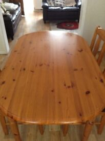 A lovely pine table and three chairs very good condition