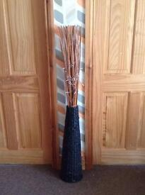 Rattan vase with twigs and lights