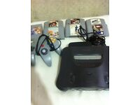 nintendo 64 with 7 games and controller