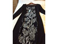 Black long sleeved M&S dress.Size 14. Patterned centre front and back, never worn.