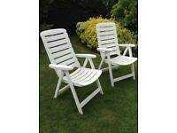 2x White plastic folding chairs