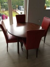 Solid Oak dinning room table and chairs