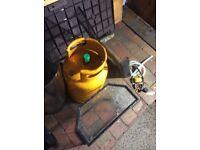 1/4 full yellow calor gas bottle used for super ser