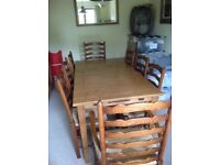 Solid oak dining table, six chairs and two carvers. 6ft long extends to 8ft. Beautiful condition.