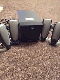 Subwoofer and speakers includes dell monitor and keyboard