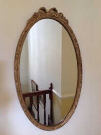 STUNNING LARGE ANTIQUE GILT FRAMED MIRROR, BOW TO TOP