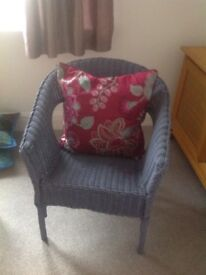 Wicker chair in purple