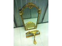 Bronze frame Wall mirror with a pierced gild figural details and shaped plate & mounted console